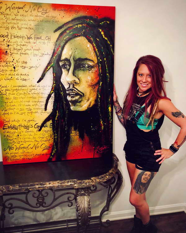 Lauren Presents the completed Bob Marley Painting