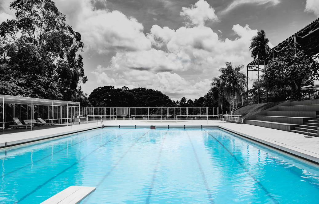blue swimmnig pool grey surroundings