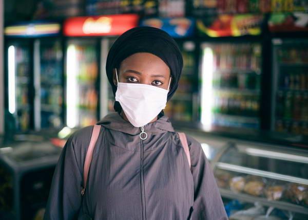 Women wearing medica mask in a store