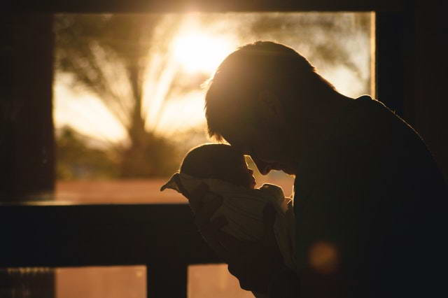Becoming A Dad Silhouette of father and baby